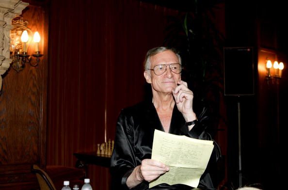 Hef reads his Movie Notes on a  Friday evening at the Mansion