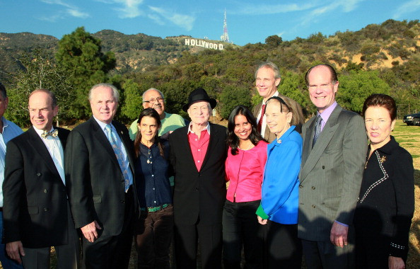 (L-R) President of the City of Los Angeles Department of Recreation and Parks Commissioners Barry Sanders, Los Angeles city councilmember Tom LaBonge, AIDS activist Aileen Getty, honorary mayor of Griffith Park Louis Alvarado, Playboy founder Hugh M. Hefner, Tiffany Foundation's Anisa Kamandoli-Costa, Trust for Public Land's Will Rogers, Tiffany Foundation's Fernanda Kellogg, Hollywood Sign Trust chairman Chris Baumgart and Governor Schwarzenegger's office representative Billie Greer attend an event celebrating the expansion of Griffith Park at Lake Hollywood Park on December 9, 2010 in Los Angeles, California
