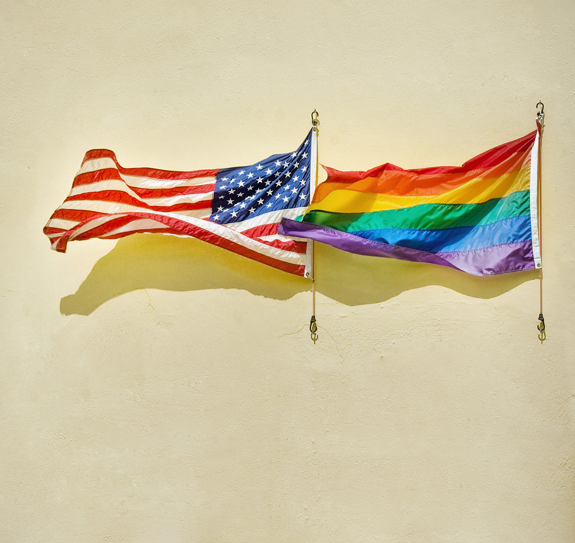 American and rainbow flags waving