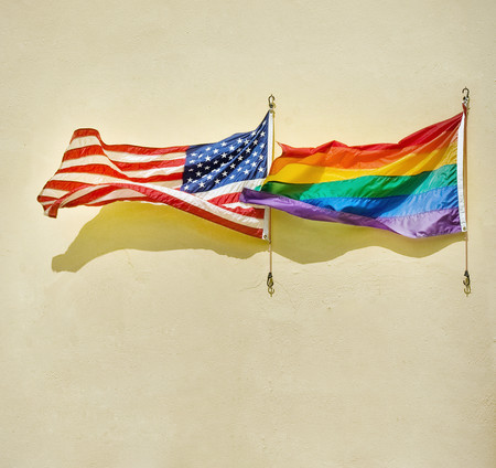 American and rainbow flags waving