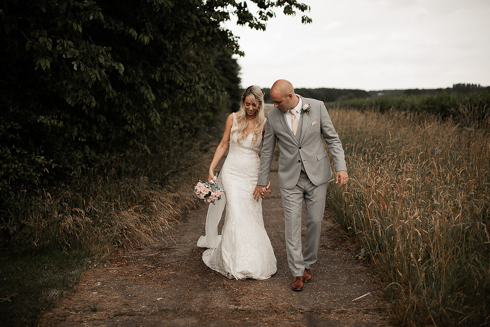 bride and groom country lane