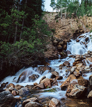 Waterfall through mountain forest