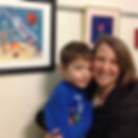 "Mitzie Testani and her son at the Syracuse Technology Garden's Fun in Space show, where she was awarded an honorable mention for her ""Spaghetti Planet"" painting. Photo Credit: Steve Nyland."
