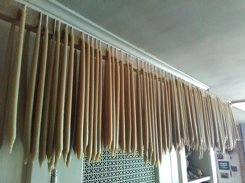 beeswax candles drying