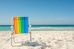 Gay pride rainbow chair at the beach.jpg