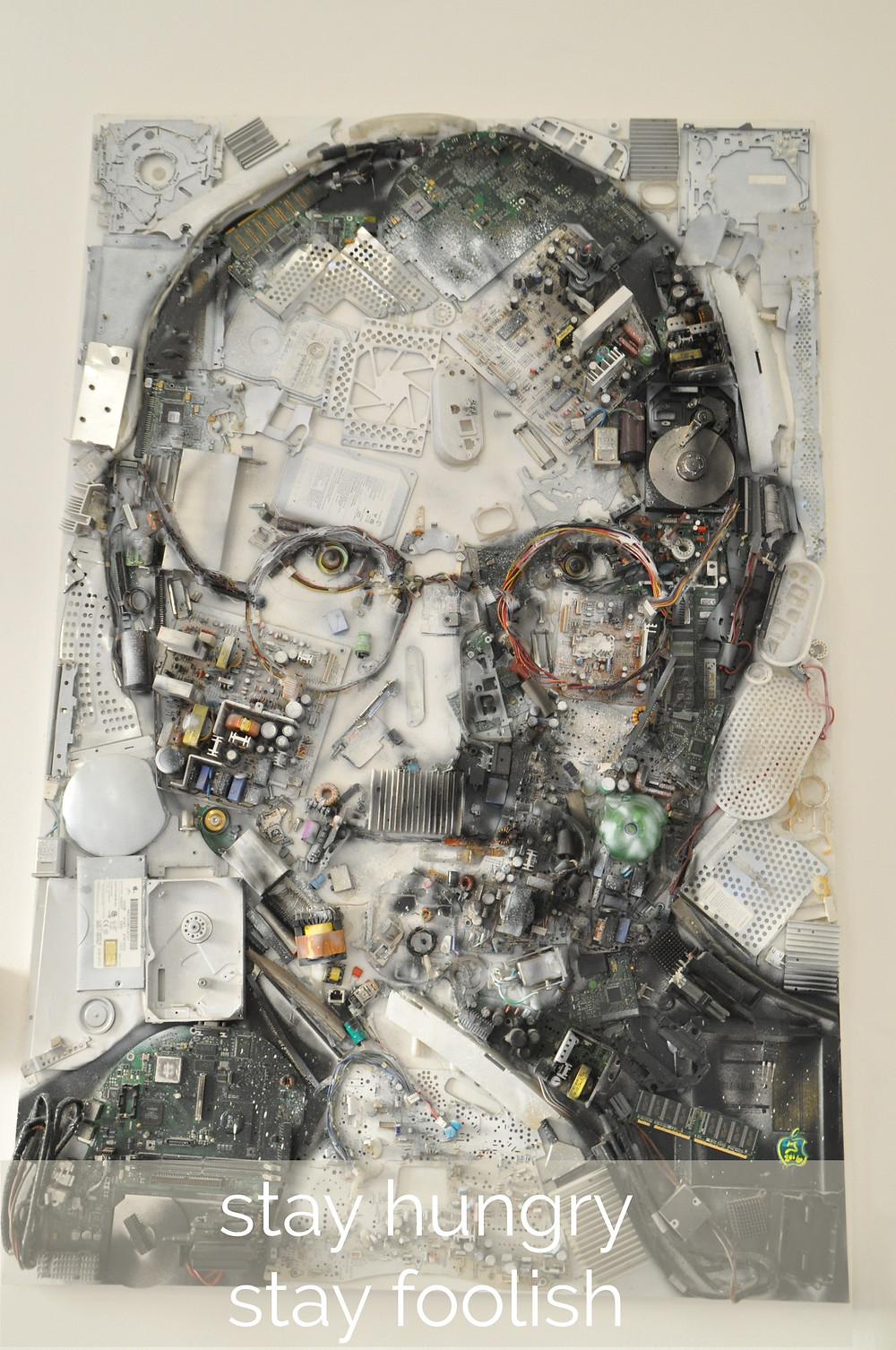 Steve Jobs portrait composed from Mac parts.