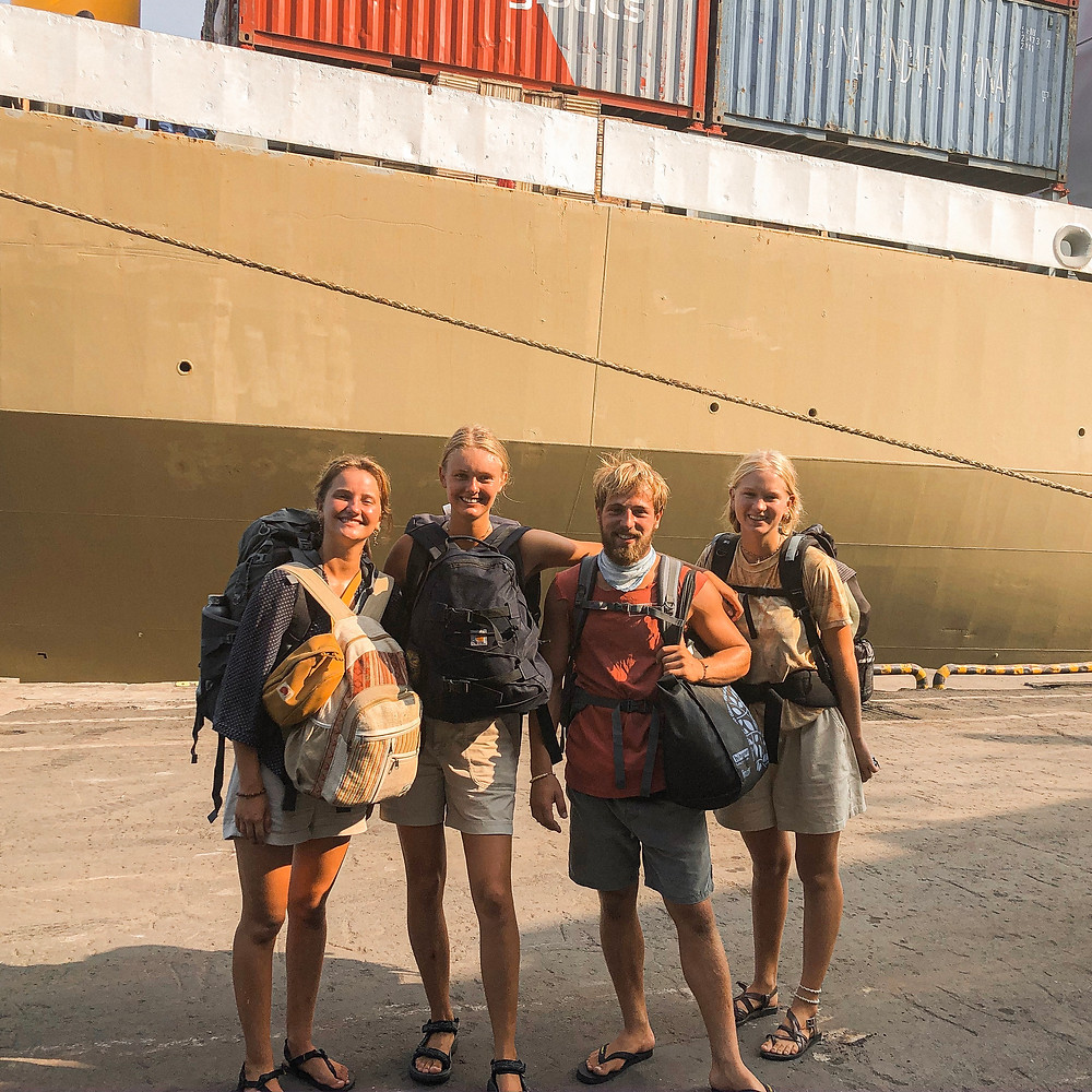 4 young people boarding the pelni ferry