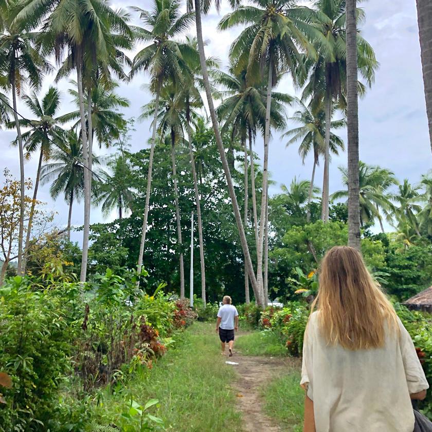 Woman walking in local village on paradise island in Raja Ampat