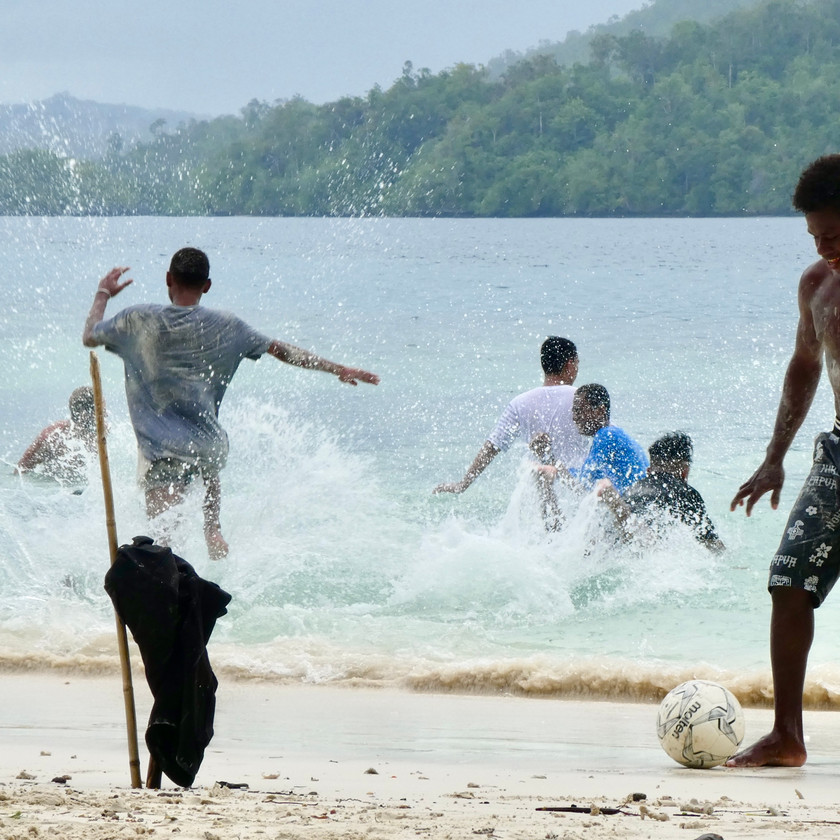 Locals playing football on small island in Raja Ampat