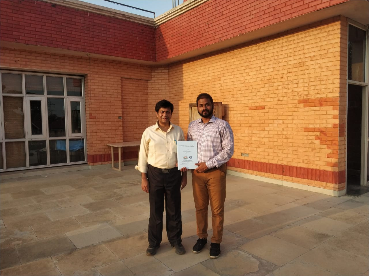 Dr. Nitya with Prof. Abir De Sarkar.