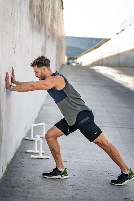 Man doing workout using walls