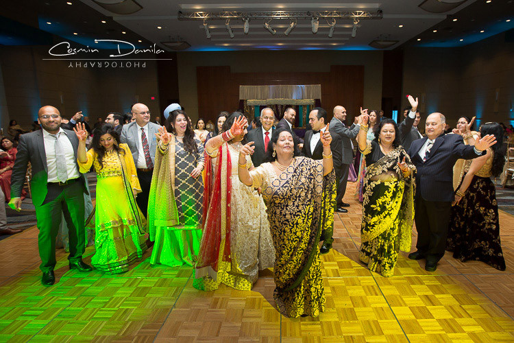 Indian Family dancing during Wedding reception