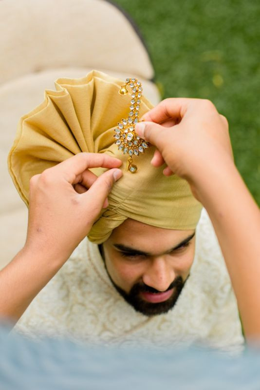 Indian groom getting styled