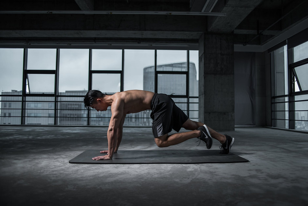 Man doing mountain climbers at home
