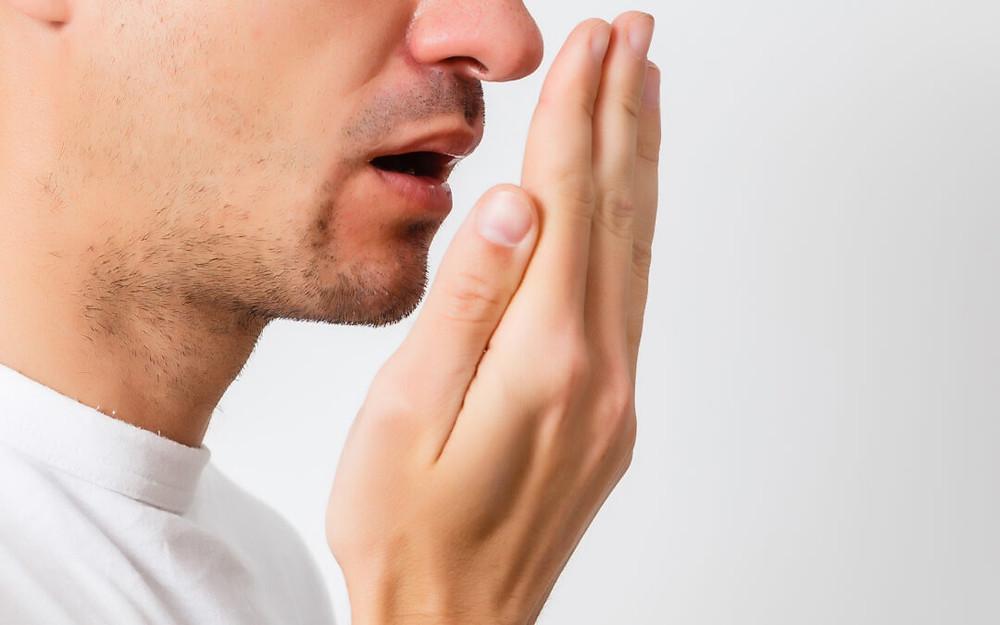 Men checking his breath