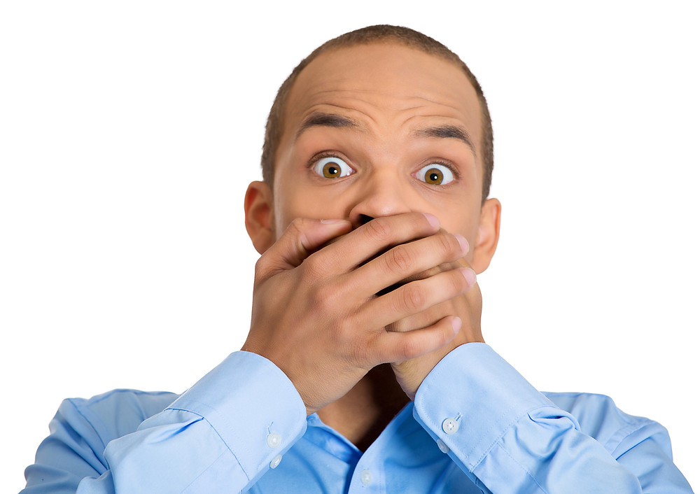 MEn with bad breath covering his mouth
