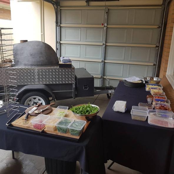 Wood oven pizza setup