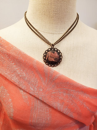 Antique bronze and polymer pendant necklace
