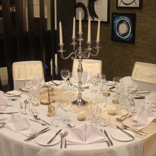 Dressed table with silver candelabra centre piece - Crowne Plaza Basingstoke