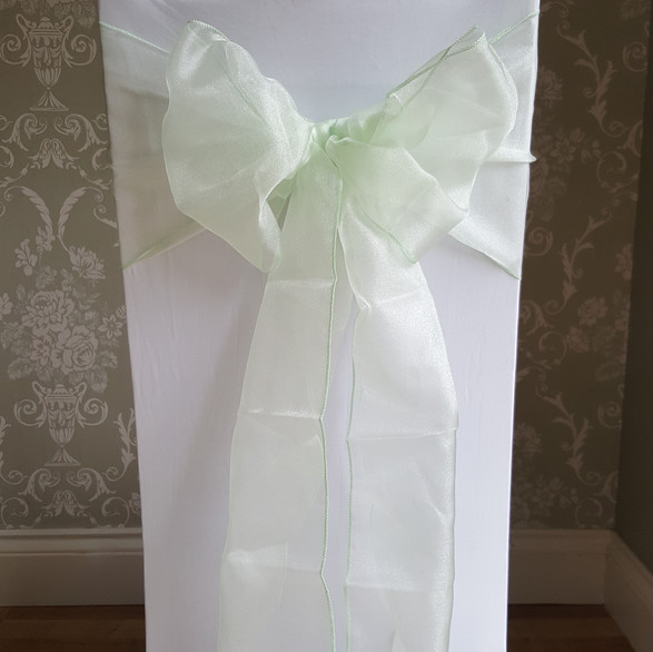 Dressed chair with mint sash