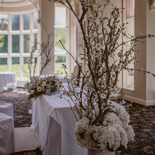 Flowered Urns featured in Ceremony room