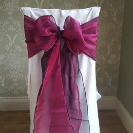 Dressed chair with black and magenta sashes