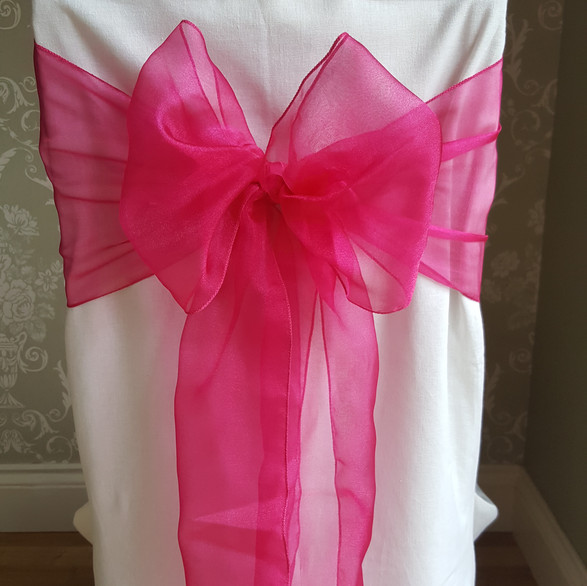 Dressed chair with bright pink sash