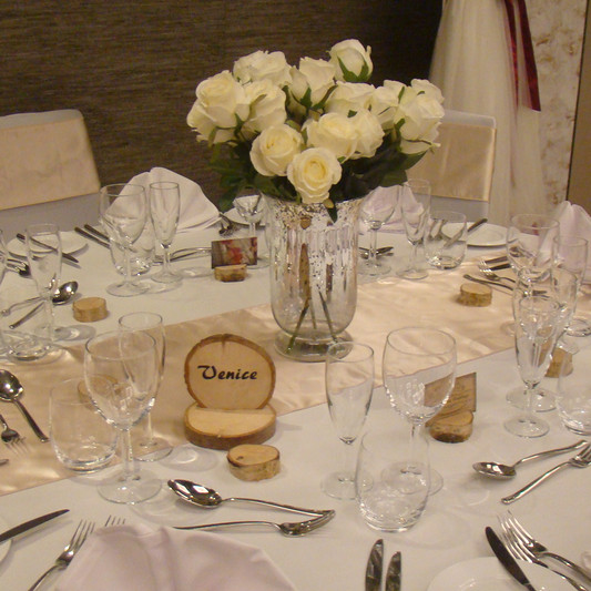 Dressed table with hurricane vase centre piece - Crowne Plaza Basingstoke