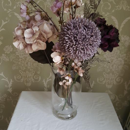 vase and faux flower arrangement