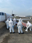 Preparing and loading patients on the ramp at Jakarta