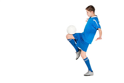 young-boy-with-soccer-ball-doing-flying-