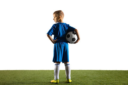 young-boy-as-a-soccer-or-football-player