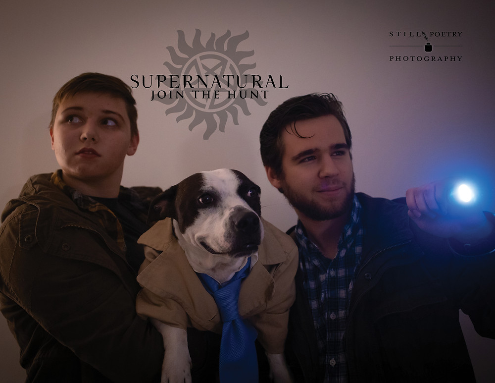 couple dressed up as supernatural characters sam and dean with dog dressed up as castiel