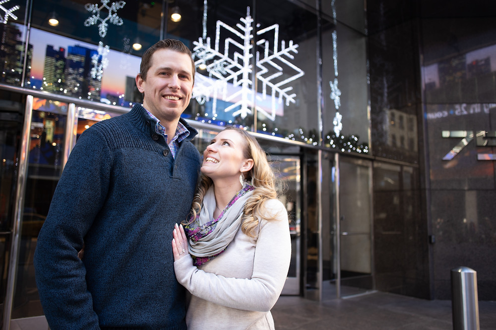 woman looking up at fiance during engagement session in new york city