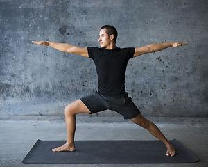 Man practicing yoga against a urban back