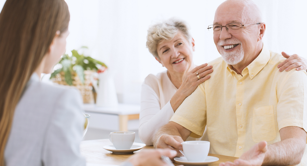Elderly couple meeting their live-in carer