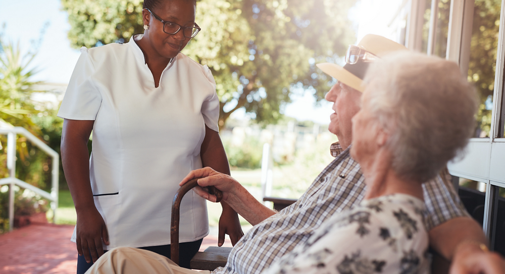 Live-in carer checking in on elderly clients