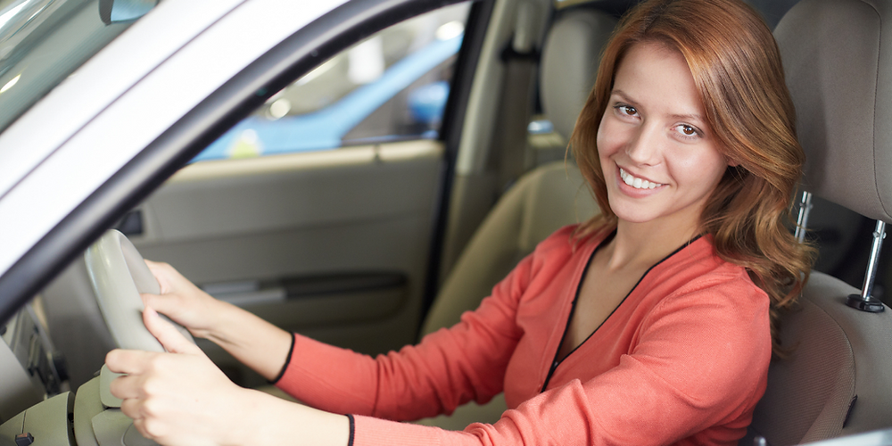 Young Woman Working As A Live-in carer in a car