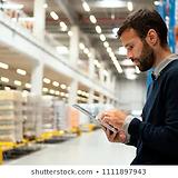 manager-holding-digital-tablet-warehouse