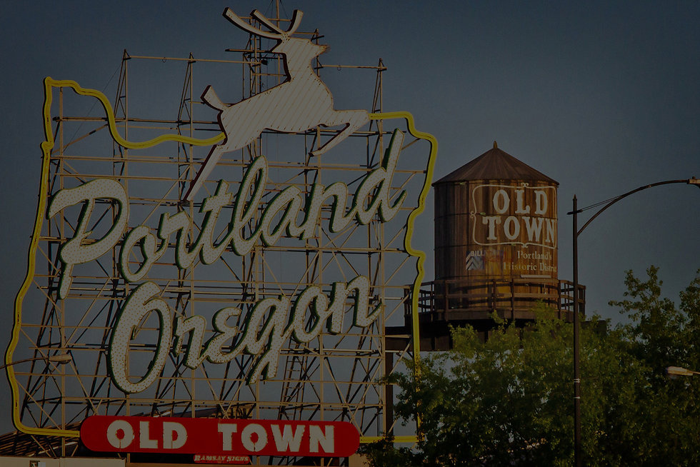 The photo of Portland Oregon sign located atop the White Stag Building in downtown Portland, Oregon. This sign is one of the most instantly recognizable local landmarks.