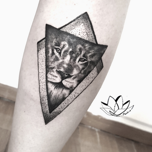 Realistic lion in triangle custom tattoo