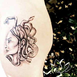 Goddess medusa hips realistic tattoo