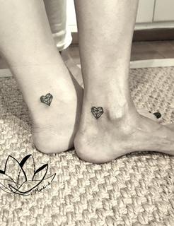 Jewel heart tattoos for two besties