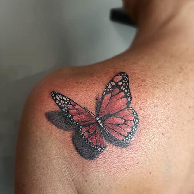 Red realistic shoulder tattoo design