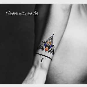 Mandala style wrist band tattoo design