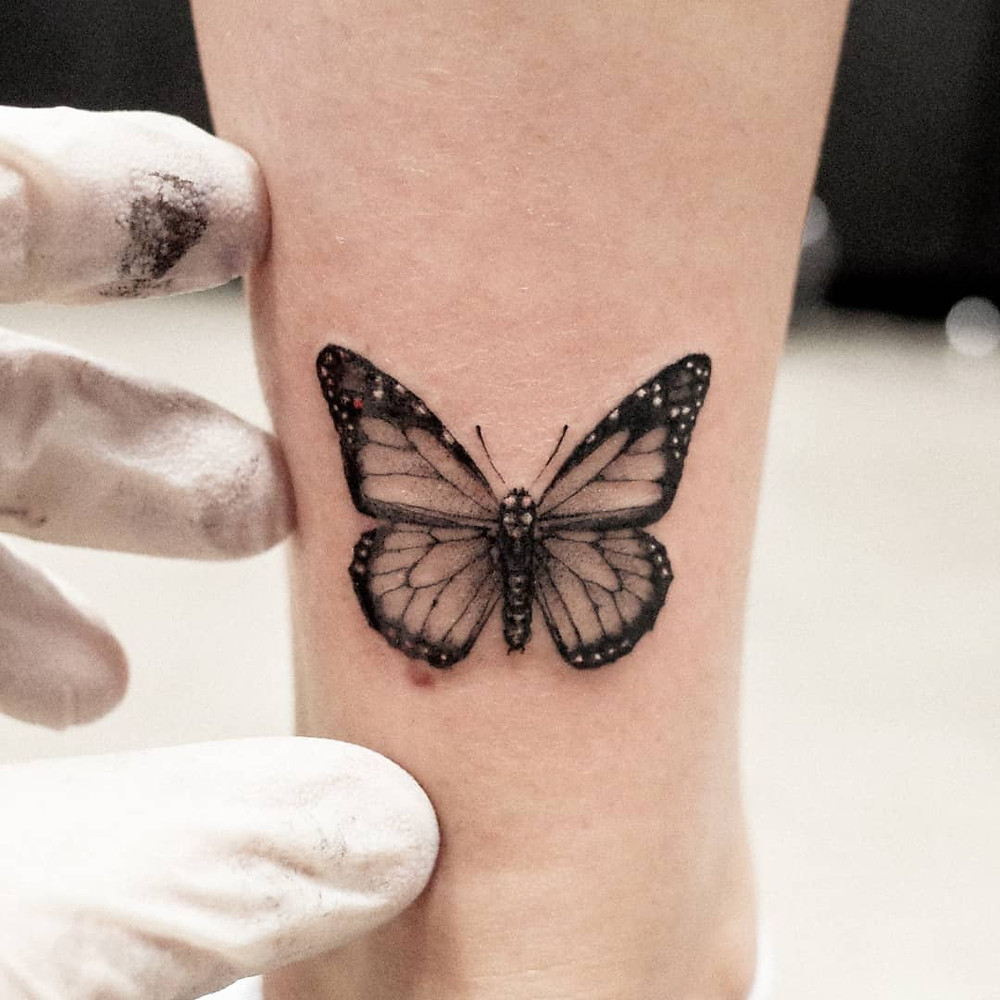 Realistic leg tattoo design