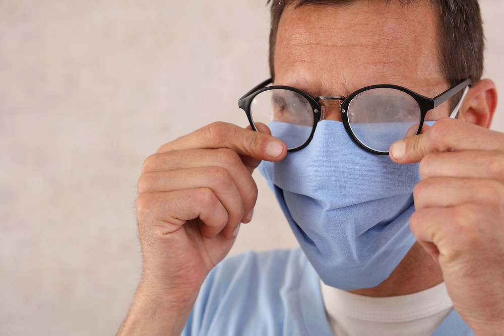 Medical professional with foggy glasses while wearing a ppe mask