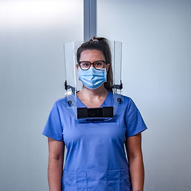Healthcare professional in blue scrubs wearing the Ultralite Total Comfort Face Shield