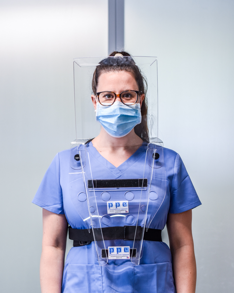 Female in blue medical clothing wearing The Compact Total Comfort Face Shield™