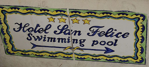 A tiled sign for Hotel San Felice's swimming pool